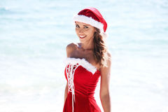 Mrs. Claus on tropical beach. Beautiful woman in Mrs. Claus custume on tropical beach, Christmas vacations concept royalty free stock photos