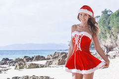 Mrs. Claus on tropical beach Stock Images