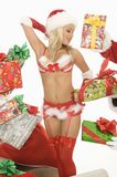 Mrs. Claus In Underwear Surrounded By Gifts Royalty Free Stock Image