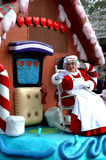 Mrs. Claus waves to the Crowd. Mrs. Claus waves to people attending the Walt Disney World Christmas Day Parade in Orlando, Florida stock image