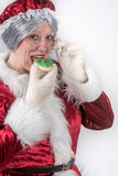 Mrs Clause has a cookie Royalty Free Stock Image