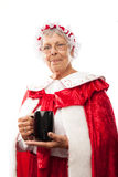 Mrs. Clause holding a cup. Image isolated on white stock photos