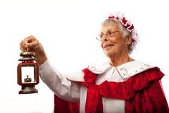 Mrs. Clause holding lantern. Isolated on white royalty free stock images