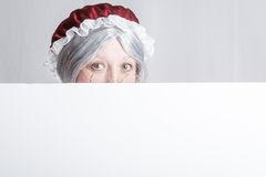 Mrs Clause peeking Stock Photography
