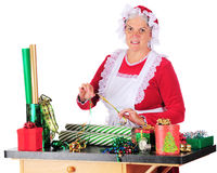 Mrs. Clause Wrapping Gifts Stock Photo