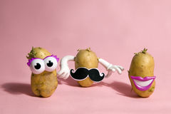 Mrs and mister patato. A pop and minimal potato portrait on a pink background Stock Photography