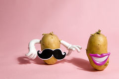 Mrs and mister patato. A pop and minimal potato portrait on a pink background Stock Photos