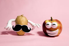 Mrs and mister patato. A pop and minimal potato portrait on a pink background Stock Photo