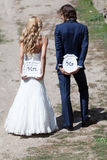 """Mrs. and Mr. …let's do it!. Married couple with funny cartons with """"Mrs. and Mr."""", acting like they are up to the adventure of their stock photography"""