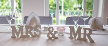 Mrs and mr wedding signs on a plain table royalty free stock image