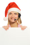 Mrs Sankt mit einem Kopfhörer Stockfotos