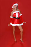 Mrs. Santa. Blond Mrs Santa in a red velvet suit stock photography