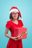 Mrs. Santa. Beautiful young asian woman in santa`s hat holding a Stock Photography