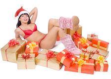 Mrs. Santa with boxes Royalty Free Stock Image