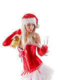 Mrs. Santa with champagne bottle Stock Images