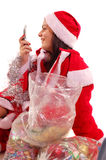 Mrs Santa Claus. A young Santa Claus with gifts talking on mobil phone looking foward and waiting Christmas's and New Year's holideys stock photo