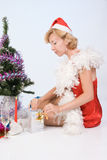 Mrs. Santa Claus looks in a gift package Stock Photos