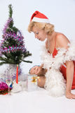 Mrs. Santa Claus looks in a gift package Stock Photo