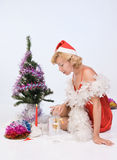 Mrs. Santa Claus looks in a gift package Royalty Free Stock Image