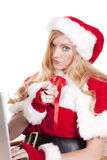 Mrs Santa computer pointing Royalty Free Stock Photos