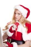 Mrs Santa computer pointing Royalty Free Stock Photos