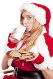 Mrs Santa cookies drink milk Royalty Free Stock Photo