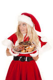 Mrs santa donuts don't get caught Royalty Free Stock Image