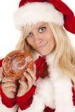 Mrs santa doughnut smirk. Mrs santa caught with a big doughnut she has a smirk on her face royalty free stock photo