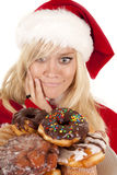 Mrs Santa Dounuts Decide Royalty Free Stock Photography
