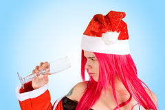 Mrs. Santa with empty glass Royalty Free Stock Photography