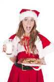 Mrs Santa excited cookies milk Stock Images