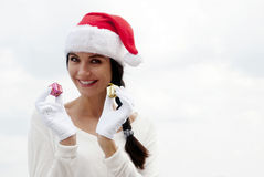Mrs. Santa with a gift box. Portrait Mrs. Santa with a gift box Royalty Free Stock Images
