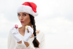 Mrs. Santa with a gift box. Stock Photo