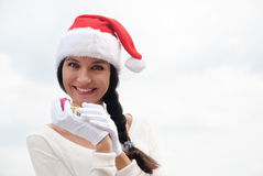 Mrs. Santa with a gift box. Happy Mrs. Santa with a gift box Royalty Free Stock Photos