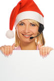 Mrs. Santa with a headset Stock Photos