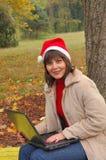 Mrs Santa Laptop stock images