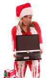 Mrs Santa Laptop. A very Mrs. Santa Claus offering a notebook computer with a fully blank screen royalty free stock photos