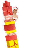 Mrs. Santa with a number of gift boxes. Stock Photography