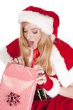 Mrs Santa open gift surprised Stock Photo