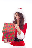 Mrs. Santa opening a gift box Royalty Free Stock Photo