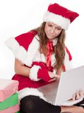 Mrs Santa pointing at computer with a scowl Royalty Free Stock Images
