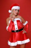 Mrs. Santa Points Royalty Free Stock Photography