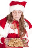 Mrs Santa smelling cookies Royalty Free Stock Images