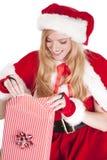 Mrs Santa wraps a gift Royalty Free Stock Image