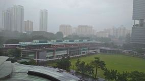 MRT station in rain. Trains stopping at Buona Vista MRT station during rainy weather stock photography