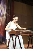 Ms chenyingjia play zither. Teacher chenyingjia of xiamen xinghe ( stars river ) art center playing guzheng, amoy city, china Stock Images