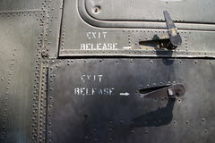 MS Detail of rivet pattern and exit latches on captured USAF aircraft in Vietnam Royalty Free Stock Photography