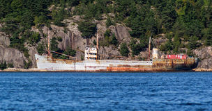 MS Hamen - Old vessel ready for circulation. This vessel name is MS Hamen, an old vessel built 1949 ready for circulation, to be demolished for scrap metal. The Royalty Free Stock Photos