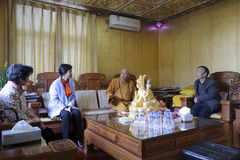Ms huangling meeting dingheng abbot. One of xiamen city leaders ms huangling visit the abbot of guanyinsi temple dingheng before the spring festival, 2015 Royalty Free Stock Photography