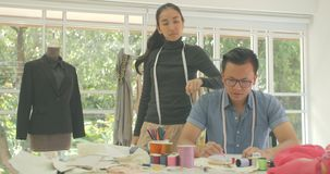Portrait of attractive asian couple fashion designer looking at camera stock video